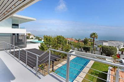 View from the front balconies of the new pool, patios and garden and the sea
