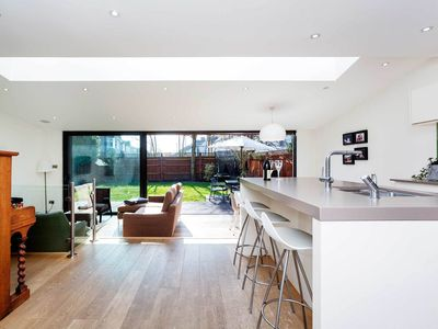 Photo for Home sleeps 7 with parking and private garden in friendly Wimbledon (veeve)