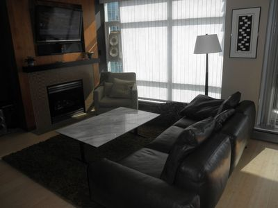 Italian leather sofa, 46 inch flatscreen TV, fireplace, Carerra marble table