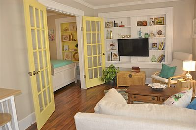 """New 40"""" Smart TV in living room. French doors lead  to the bedroom."""