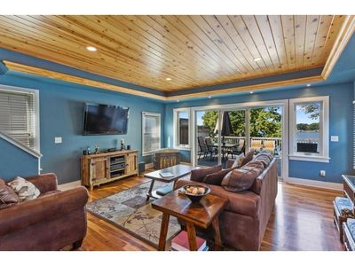Living Room with direct deck access over looking the lake