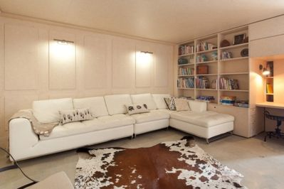 relax put your feet up you deserve it... Media room and library full with kids activities and books