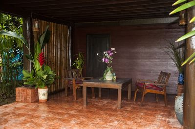 The covered alfresco living area creates a shady space for relaxing and enjoying the flora and fauna.
