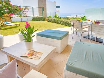 Photo for Magnificent apartment with terrace and garden overlooking the sea and the Golf