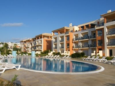 Photo for Luxurious first floor apartment with balconies overlooking pool and gardens.