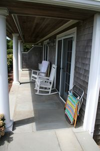 Covered 1st floor patio with rockers