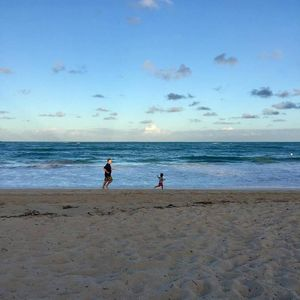 Location Location! Visiting grandson enjoying the beach in front of our lane.