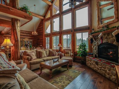 Photo for Gorgeous hand-built log home with mountain views, shared hot tub, & pool