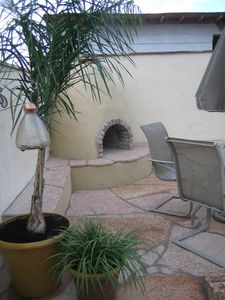 Restful area for dining with Beehive Fireplace in Back Gardens
