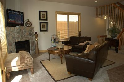 """The main living room with beautiful leather sofas and a 42"""" TV"""