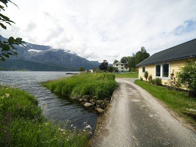 Photo for Helle Gard - Idyllic fjordside cabin