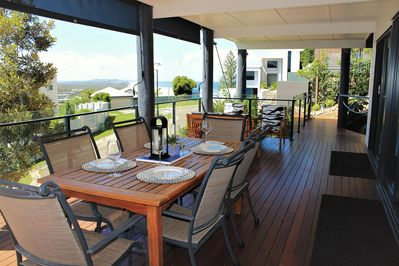 Deck dining seats 6 has a barbeque and ocean views..