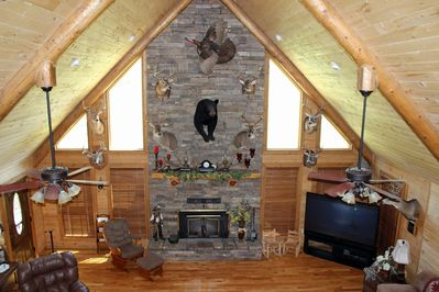 View of Floor-to-Ceiling Wood Burning Fireplace.