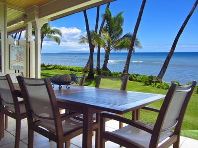 Lanai off the living room downstairs. Table seats 8-10 guests. Lounge chairs too