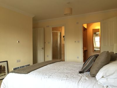 Master bedroom with ensuite shower and dressing room