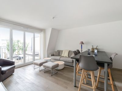 Photo for Modern flat with large balcony 10 min to Paris and La Défense - Welkeys