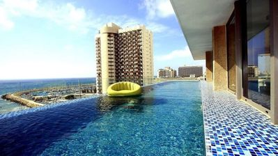 Photo for Stunning duplex penthouse with infinity rooftop pool, parking, ample space