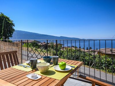 Photo for In the mountains with a fantastic lake view - Apt Barone with spa