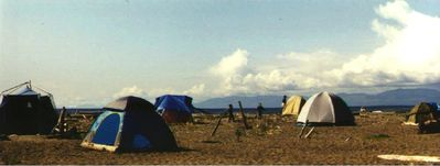 Tents on the beach on the Hoko River mouth.  Canada across Straits.