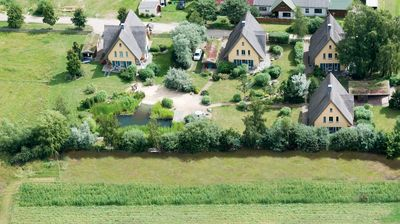 Photo for 5 stars-thatched house with swimming lake on the island Usedom