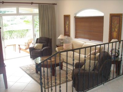 Family Room. Sliding glass doors open to Patio with golf course view. Sofa bed.