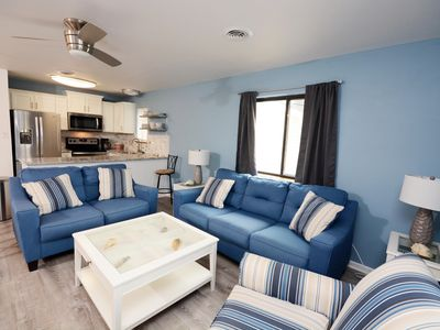 Photo for Upscale, newly-remodeled 2 bedroom bayfront condo with free WiFi and boat slip located uptown and only four blocks to the beach!
