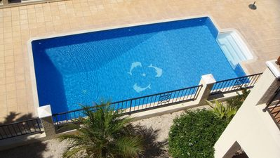 Large Swimming Pool Complete With Dolphins!