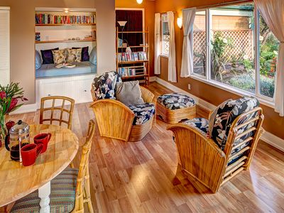 Light filled living room, dining area and cozy reading nook