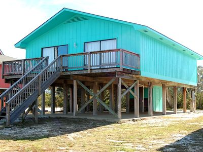 Andrews Cottage is a pet friendly Gulf Shores Beach House Rental with a pier!