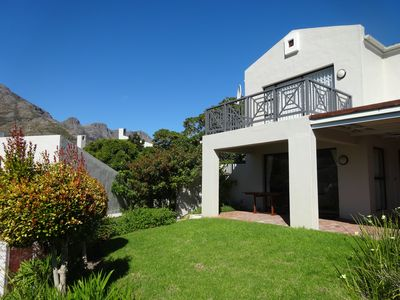 Photo for Quiet location, mountain view, all the mod cons . Walk to beach, harbour, shops.