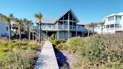 """Photo for Bask in beachfront Plantation paradise! Private Boardwalk, Beach Gear, Wi-Fi, """"Our Rogue Pirogue"""""""