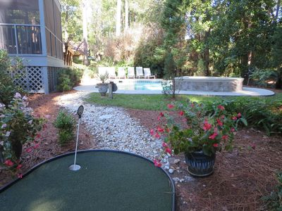 Poolside professional synthetic three hole  putting green.