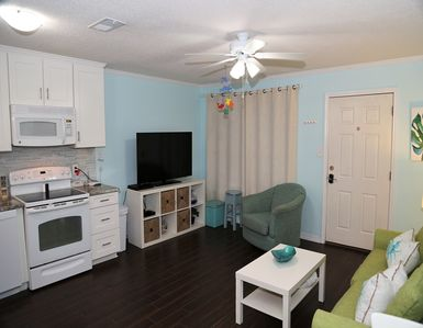 Photo for Lagoon Landing 303  ~ REMODELED ~ Waterfront Condo ~ Boat Friendly ~ Bbq GRILLS ~ Comfort + Style