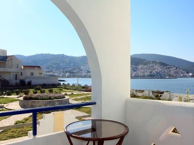 Photo for Seafront apartment for 2-4 guests with shared pool, in walking distance to town.