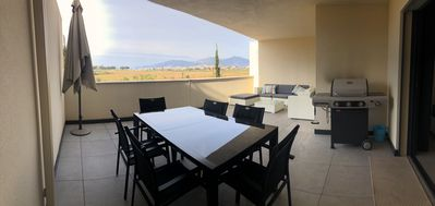 Photo for APARTMENT STANDING PORTICCIO CENTER LARGE TERRACE BARBECUE AND BEACH FEET