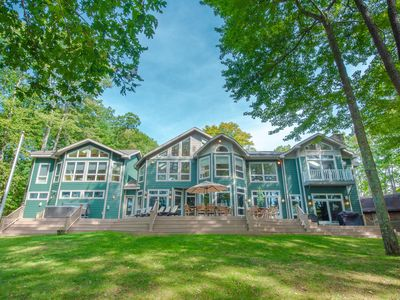 Lakefront home with dock slip, hot tub, sun room and ping pong table!
