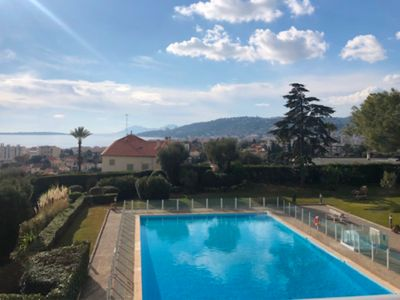 Photo for 2 rooms sea view, swimming pool Antibes, wifi & parking
