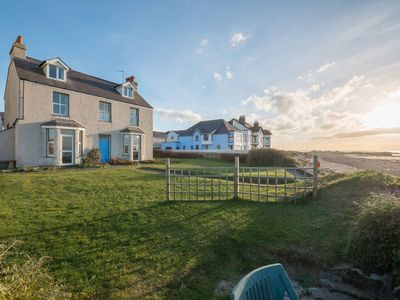 Photo for Min Y Mor - A holiday home on the edge of the sea in Anglesey