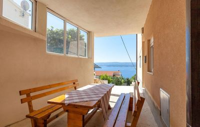 Photo for Two bedroom apartment with terrace and sea view Stanići, Omiš (A-17894-c)