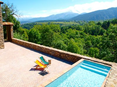 Chlorine-free pool of villa Cal Pesolet, with wild forest mountains panorama