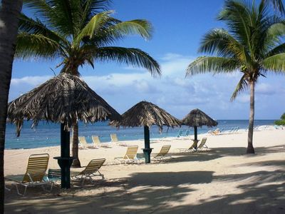 There are permanent palapas and lots of lounge chairs on your uncrowded beach