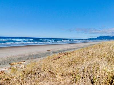 Photo for Bright, oceanfront cottage w/private beach access & hot tub - dog-friendly too!