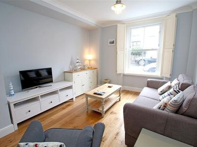 Photo for This charming period coastal cottage is in the heart of Mumbles, close to the beach, stylish shops,