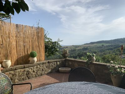 Photo for Town house with private garden beautiful views over Tuscany 1 min walk to square