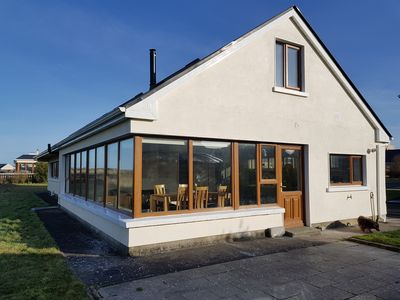 Photo for Perched on the edge of Enniscrone golf course with panoramic views.