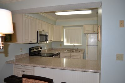 New updated kitchen featuring  custom cabinets and stainless steel appliances