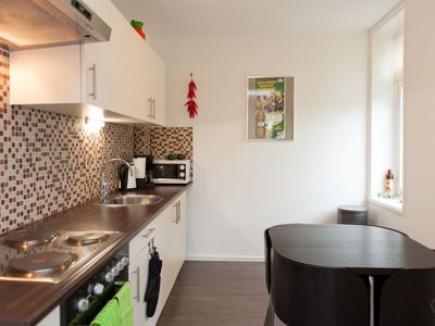 Compact and comfortable one-bedroom apartment with garden, for up to four guests, in the trendy and