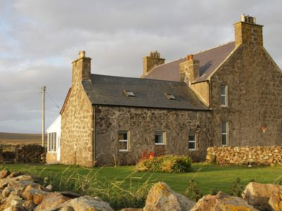 Photo for Traditional cottage on UK's northernmost island in peaceful bay