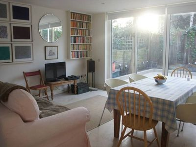 Photo for 2 bed ground floor flat in vibrant Camden, reach central London quickly (Veeve)