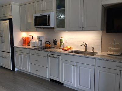 Newly renovated kitchen with top-of-the-line appliances.